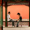 Card game, Summer Palace - Not far from the spot where 384 eunuchs once held operatic performances for the Empress Cixi, a young couple share an afternoon card game.