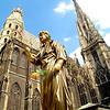 Street performer, Stephansdom - Standing the center of Vienna since the 13th Century, the Stephansdom soars 450 feet over the city. Thousands of visitors are entertained by street performers in its vast Stephansplatz.