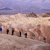 Photographers, Zabriskie Point - Every morning, photographers set up their tripods on this rock to shoot the effect of the rising sun on the rocks of Death Valley's most famous lookout. I made this image just before sunrise.