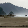 On the Beach at Hug Point State Park - There are no bathers here, only photographers, joggers and beachcombers. This is a typical Oregon coast day in June: 50 degrees and drizzling.